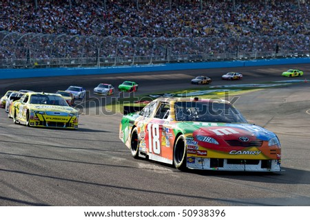 AVONDALE, AZ - APRIL 10: Kyle Busch (#18) leads a group of cars out of turn two at the Subway Fresh Fit 600 NASCAR Sprint Cup race on April 10, 2010 in Avondale, AZ. - stock photo