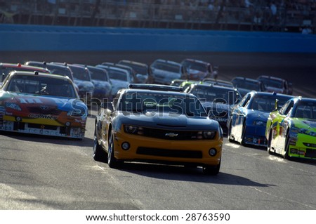 AVONDALE, AZ - APRIL 18: The pace car leads the field at the start of the NASCAR Sprint Cup race at the Phoenix International Raceway on April 18, 2009 in Avondale, AZ. - stock photo