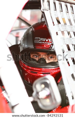AVONDALE, AZ - FEB 25: Jeff Gordon (24) in his car before a practice session for the SUBWAY Fresh Fit 500 race on Feb. 25, 2011 at the Phoenix International Raceway in Avondale, AZ. - stock photo