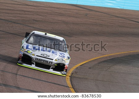 AVONDALE, AZ - FEB 25: Jimmie Johnson (48) at speed in a practice session for the SUBWAY Fresh Fit 500 race on Feb. 25, 2011 at the Phoenix International Raceway in Avondale, AZ.