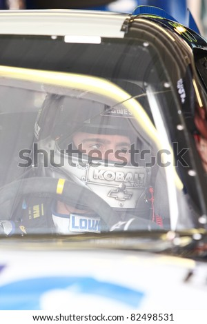 AVONDALE, AZ - FEB 25: Jimmie Johnson (48) in his car before a practice session for the SUBWAY Fresh Fit 500 race on Feb. 25, 2011 at the Phoenix International Raceway in Avondale, AZ. - stock photo