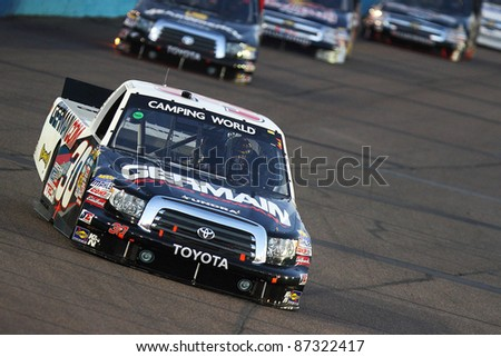 AVONDALE, AZ - FEB 25: Todd Bodine (30) dives into turn one during the NASCAR Camping World Truck Series, Lucas Oil 150 race on Feb. 25, 2011 at the Phoenix International Raceway in Avondale, AZ. - stock photo