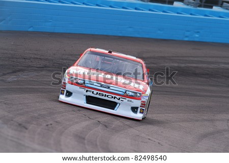 AVONDALE, AZ - FEB 25: Trevor Bayne (21) at speed in a practice session for the SUBWAY Fresh Fit 500 race on Feb. 25, 2011 at the Phoenix International Raceway in Avondale, AZ.