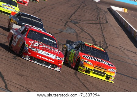 AVONDALE, AZ - NOV 14: Aric Almirola (9) and Jeff Gordon (24) fight for position in the Kobalt Tools 500 race on Nov 14, 2010 at the Phoenix International Raceway in Avondale, AZ. - stock photo
