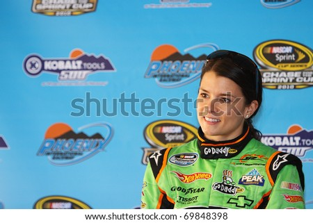 AVONDALE, AZ - NOV 12: Danica Patrick talks with the press before qualifying for the WYPALL * 200 race on Nov 12, 2010 at the Phoenix International Raceway in Avondale, AZ. - stock photo