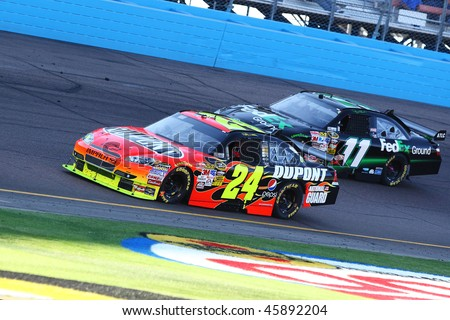 AVONDALE, AZ - NOV. 15:Jeff Gordon (24) and Denny Hamlin (11) during the NASCAR Sprint Cup Series, Checker O'Reilly Auto Parts 500 at Phoenix International Raceway on Nov. 15, 2009 in Avondale, AZ. - stock photo