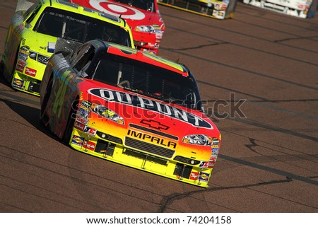 AVONDALE, AZ - NOV 14: Jeff Gordon (24) at speed in the Kobalt Tools 500 race on Nov 14, 2010 at the Phoenix International Raceway in Avondale, AZ. - stock photo