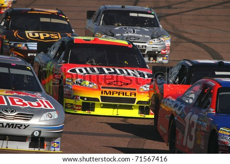 AVONDALE, AZ - NOV 14: Jeff Gordon (24) in traffic during the Kobalt Tools 500 race on Nov 14, 2010 at the Phoenix International Raceway in Avondale, AZ. - stock photo