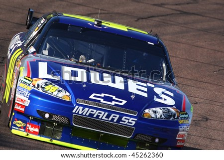 AVONDALE, AZ - NOV. 14: Jimmie Johnson (48) gets laps in during a practice session for the NASCAR Sprint Cup race, at Phoenix International Raceway on Nov. 14, 2009 in Avondale, AZ. - stock photo