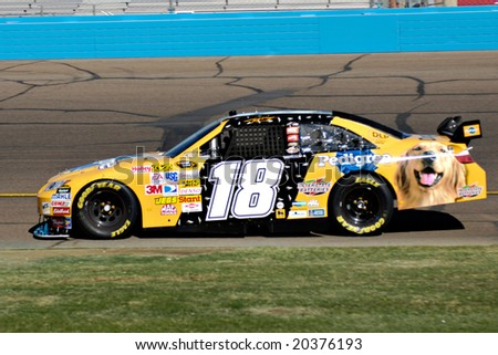 AVONDALE, AZ - NOV 7 - Kyle Busch (18) competes in the NASCAR Sprint Cup Series at the Phoenix International Raceway on November 7, 2008 in Avondale, Arizona. - stock photo