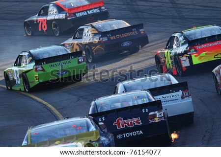 AVONDALE, AZ - NOV 14: Regan Smith (78) leads a group of cars during the Kobalt Tools 500 race on Nov 14, 2010 at the Phoenix International Raceway in Avondale, AZ. - stock photo