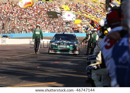 AVONDALE, AZ - NOVEMBER 15:Dale Earnhardt Jr. (88) on pit road during the NASCAR Sprint Cup Series, Checker O'Reilly Auto Parts 500 at Phoenix International Raceway on Nov. 15, 2009 in Avondale, AZ. - stock photo