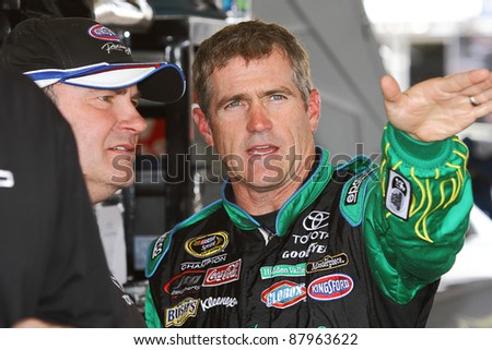 AVONDALE, AZ - OCT 4: Bobby Labonte in the garage during a NASCAR Sprint Cup track testing session on Oct. 4, 2011 at Phoenix International Raceway in Avondale, AZ. - stock photo