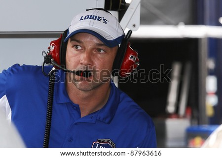 AVONDALE, AZ - OCT 4: Chad Knaus, Jimmie Johnson's crew chief looks on during a track testing session on Oct. 4, 2011 at Phoenix International Raceway in Avondale, AZ. - stock photo