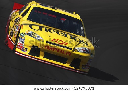 AVONDALE, AZ - OCT 5: Clint Bowyer (33) takes hot laps during a NASCAR Sprint Cup track testing session on Oct. 5, 2011 at Phoenix International Raceway in Avondale, AZ. - stock photo