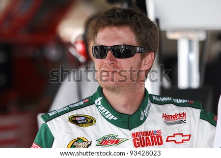 AVONDALE, AZ - OCT 4: Dale Earnhardt Jr. in the garage during a track testing session on Oct. 4, 2011 at Phoenix International Raceway in Avondale, AZ. - stock photo