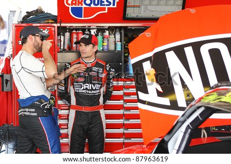 AVONDALE, AZ - OCT 4: Jimmie Johnson (left) talks with Jeff Gordon during a track testing session on Oct. 4, 2011 at Phoenix International Raceway in Avondale, AZ. - stock photo