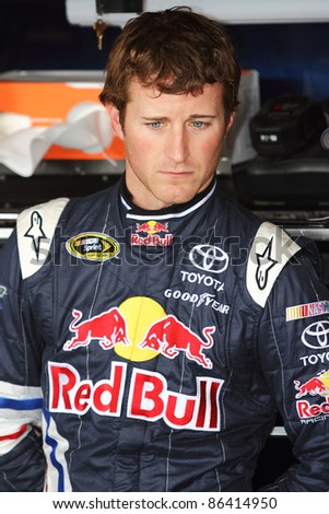 AVONDALE, AZ - OCT 4: Kasey Kahne (4) waits as the team make adjustments to his car during a track testing session on Oct. 4, 2011 at Phoenix International Raceway in Avondale, AZ. - stock photo