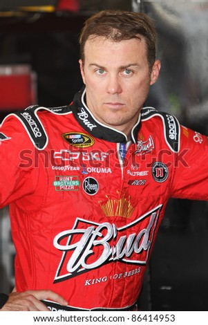 AVONDALE, AZ - OCT 4: Kevin Harvick (29) waits while the team makes adjustments to his car during a track testing session on Oct. 4, 2011 at Phoenix International Raceway in Avondale, AZ. - stock photo