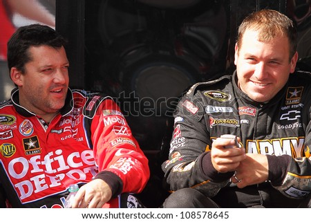 AVONDALE, AZ - OCT 5: Tony Stewart (left) and Ryan Newman (right) during a NASCAR Sprint Cup track testing session on Oct. 5, 2011 at Phoenix International Raceway in Avondale, AZ. - stock photo
