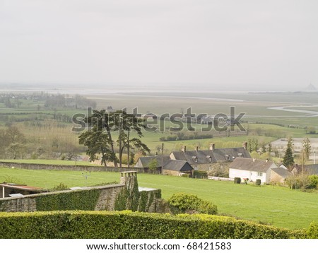 Avranches outside,  city bombed in World War II. In the background, on right, the abbey of Mont Saint Michel. - stock photo