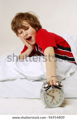 awake boy is shocked because it is too late - stock photo