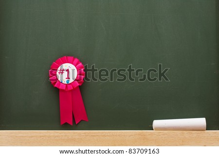Award and chalk on a chalkboard with lots of copy space, Award winning education - stock photo