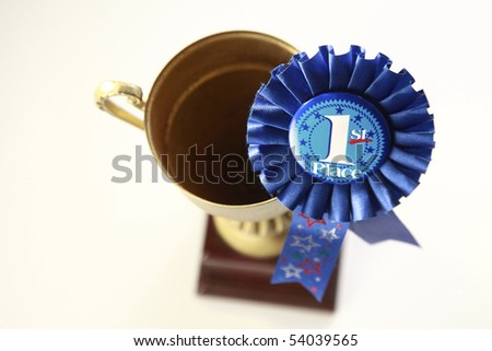 award badge and the trophy on the plain background - stock photo