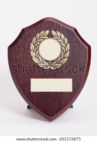 Award Mock Up. Shield Shape Trophy With Placeholder Space For Text. - stock photo