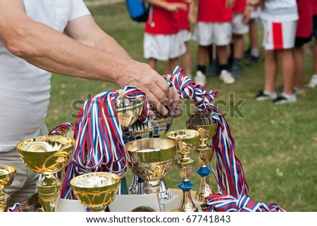 award trophy and medal winner - stock photo