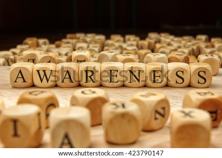 Awareness word written on wood block