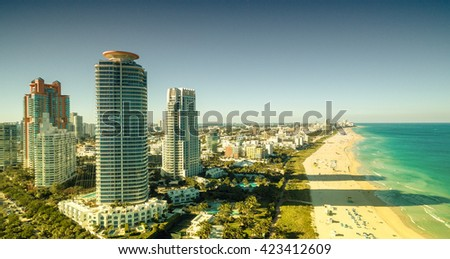 Awesome aerial view of Miami skyline from helicopter. - stock photo