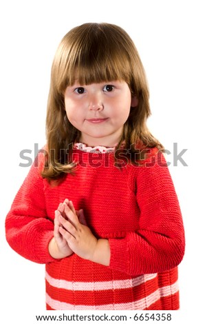 Awesome casual little girl wearing red dress praying for... isolated on white - stock photo
