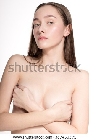 Awesome caucasian attractive sexy professional fashion model with brunette hair posing in studio topless, perfect make up, tanned skin, isolated on white background, retouched image - stock photo