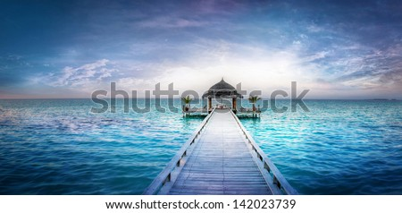 Awesome dreamy sunset over the jetty in the Indian ocean | Maldives - stock photo
