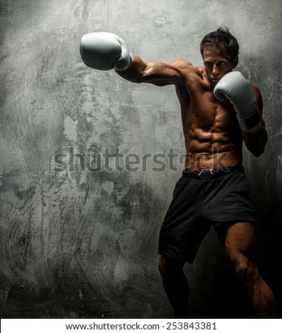 Awesome female with great antomy boxing. Grey background. - stock photo