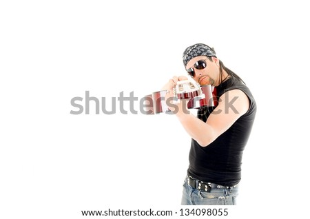 Awesome guitar player holds guitar with passion in studio - stock photo