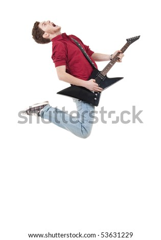 Awesome guitar player jumps with passion in studio over white - stock photo