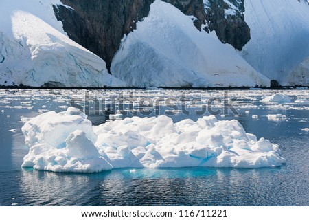Awesome iceberg drifting in Antarctic waters - stock photo