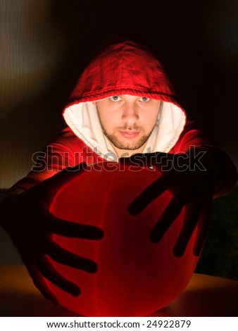 Awesome man holds ball of light in his hands - stock photo