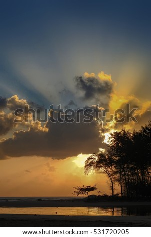 Awesome Ray of light  sunrise with marvelous clouds  ,Sun beams or light rays breaking through the clouds at sunrise.