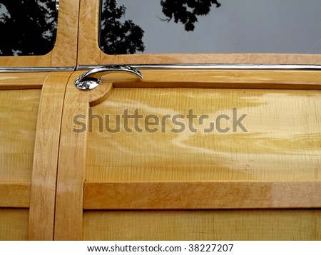 Awesome restoration of wood door panel on vintage car - stock photo
