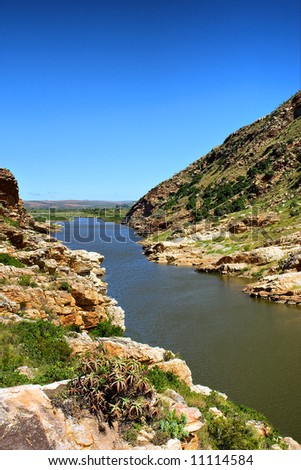 Awesome river in mountains. Shot next to the Gouritsrivier river, Garden Route, Western Cape, South Africa. - stock photo