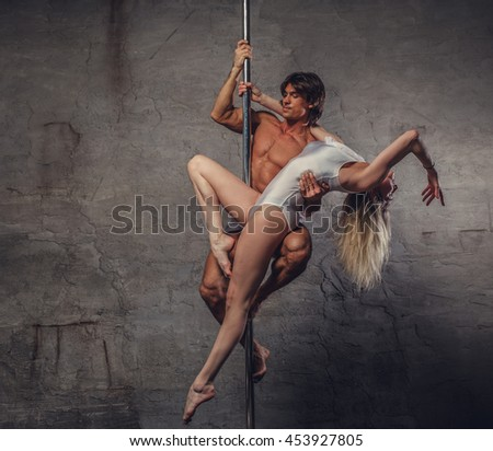 Awesome sensual couple in air on a pole dance stand.