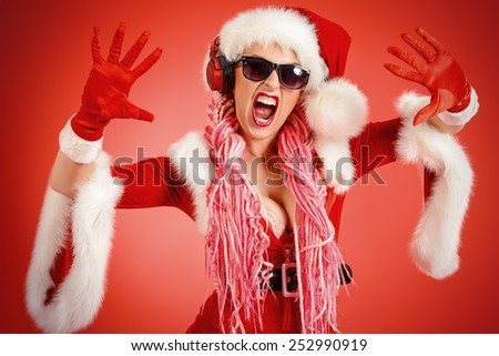 Awesome sexy Christmas girl in headphones. Red background. Christmas party. DJ girl. - stock photo