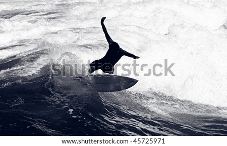 Awesome Shot of a Surfer Riding the Waves - stock photo