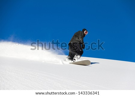Awesome snowboarder is having fun in the backcountry powder of Les Portes du Soleil in France - stock photo