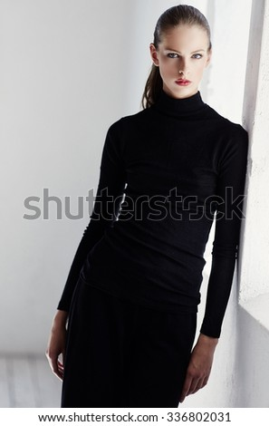 Awesome young brunette woman in black sweater. - stock photo