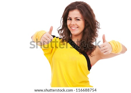 awesome young woman dancer showing both thumbs up and smiling to the camera