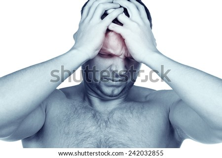 Awful headache. The young attractive guy tests a terrible migraine. A hungover syndrome - stock photo